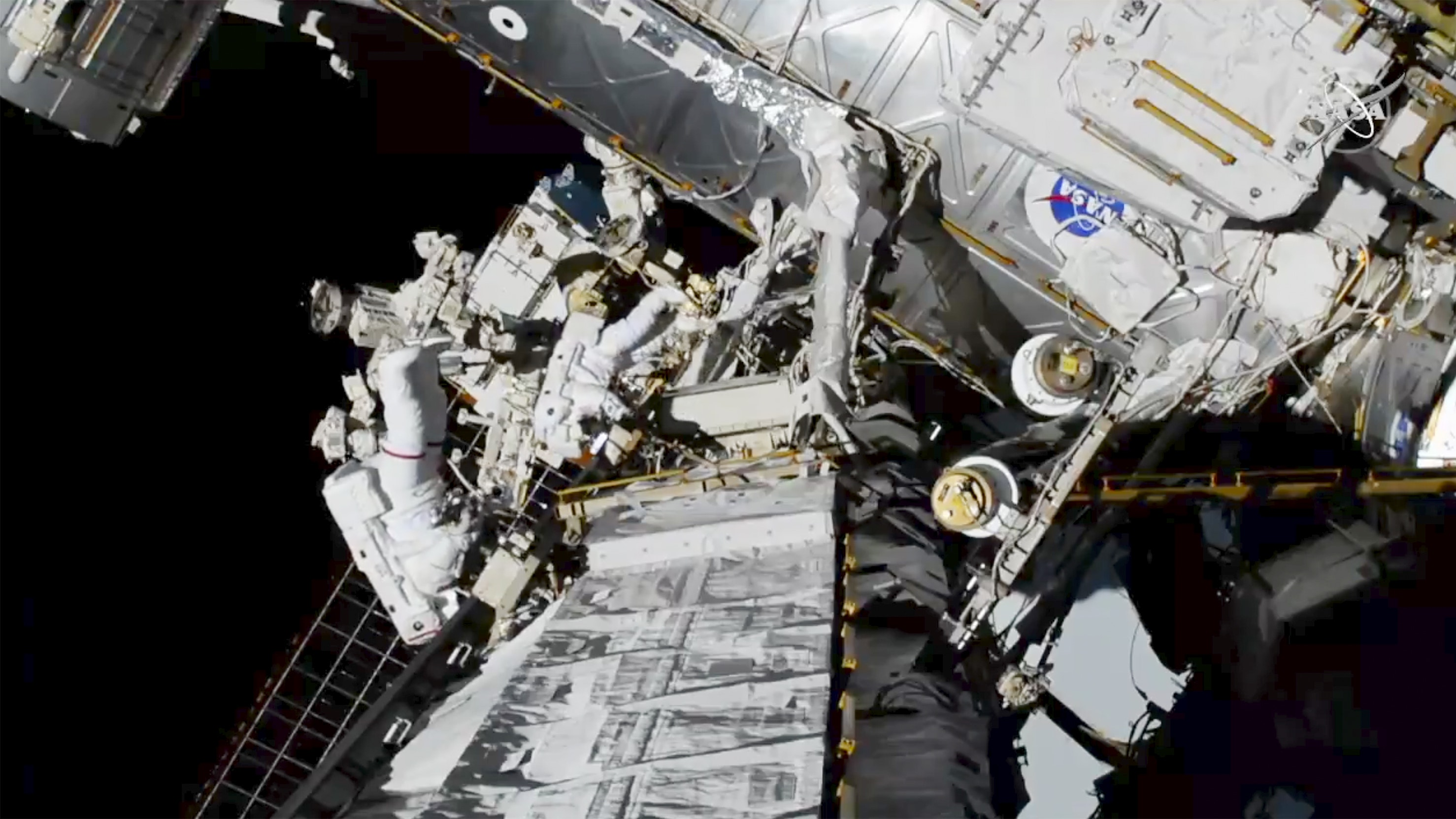 U.S. astronauts Jessica Meir and Christina Koch spacewalking
