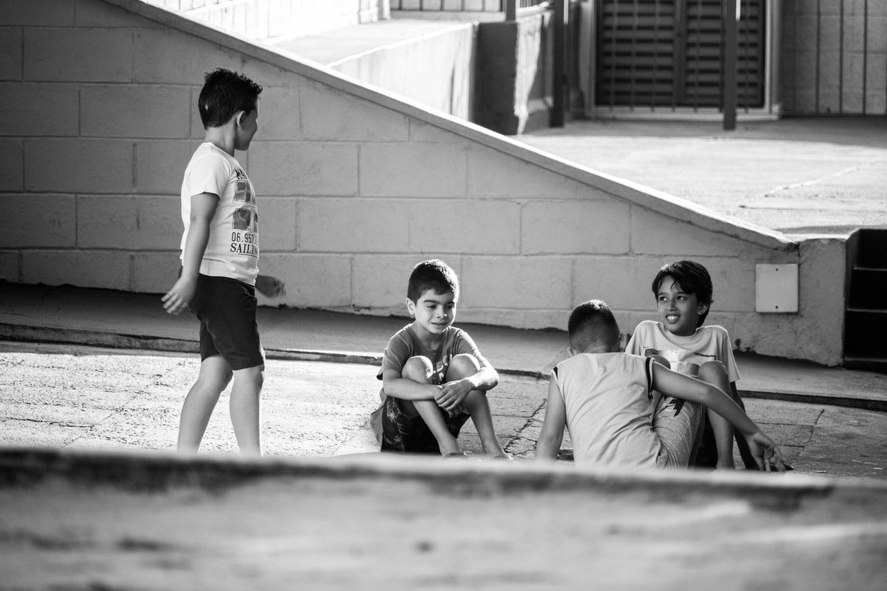 Four boys playing.