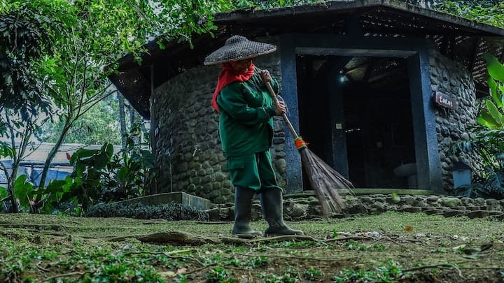 Photo of man sweeping.